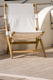 Wooden deck chair stock photo
