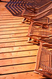 Wooden deck chairs Stock Images
