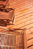 Wooden deck chairs. Abstract, outdoor swimming pool accessories Stock Photo