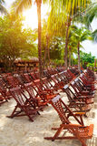 Wooden Deck Chairs in Caribbean Beach Royalty Free Stock Photos