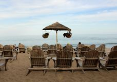 Wooden deck chairs. With an ocean view and sandy beach at holiday vacation restaurant in relaxing Malibu, California, USA Stock Photo