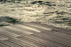 Wet Wooden Deck & Sea Stock Image