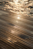Wet Wooden Deck & Sea Royalty Free Stock Photo