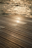 Wet Wooden Deck & Sea Stock Photos