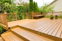 Wooden deck of family home. Wooden deck of family home at summer time stock photo