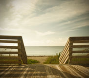 Wooden deck with fence overlooking the ocean and the beach Royalty Free Stock Image