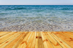 Wooden deck floor over beautiful sea background Royalty Free Stock Photo