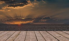 Wooden deck floor over colorful sunrise sunset background. File textured of wood terrace and colorful dusky sky with free copy space useful for background stock photography