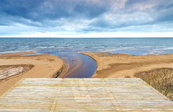 Wooden Deck Floor Over Sand Beach Of The Baltic Sea, Latvia Stock Photo