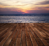 Wooden deck floor over sea and sunset background Royalty Free Stock Images
