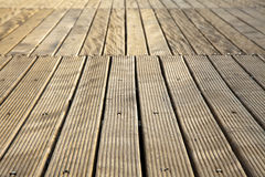 Diminishing Wooden Deck. A wooden deck floor in the sunlight, diminishing pespective royalty free stock images