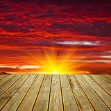 Wooden deck floor and sunset sky Royalty Free Stock Photography