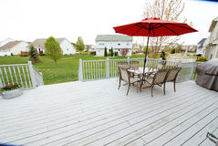 Wooden deck of home. The wooden deck of a home with a view over the back yard Royalty Free Stock Image