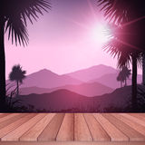 Wooden deck looking out to tropical landscape Royalty Free Stock Photography