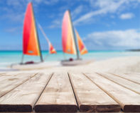 Wooden deck perspective with two colorful catamarans Royalty Free Stock Photography