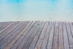 Wooden Deck at a pool. Close up of wooden deck on a pool`s edge stock images