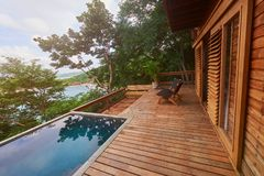 Wooden deck with pool. On natural background royalty free stock images