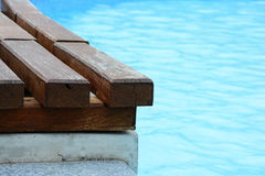 Wooden deck on the pool Stock Photos