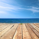 Wooden deck with sea Stock Photos