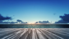 Wooden deck with sunrise over sea scenery royalty free stock photography