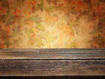 Wooden deck table with floral vintage background Royalty Free Stock Photography