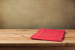 Wooden deck table with polka dots tablecloth stock photos