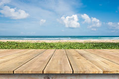 Wooden deck tabletop and Ipomoea on the beach. Stock Image