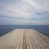 Wooden deck terrace over sea and sky. Summer background Stock Image