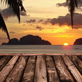Wooden deck and tropical sunset Royalty Free Stock Photography
