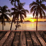 Wooden deck and tropical sunset Royalty Free Stock Photos