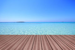Wooden deck with turquoise color waters Royalty Free Stock Photo
