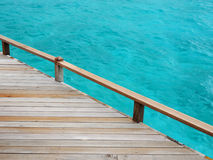 Wooden deck and turquoise water. Old wooden deck and turquoise water background Royalty Free Stock Photo