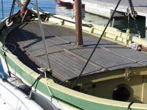 Wooden deck view of an old sailboat moored in the harbor . Livorno, Tuscany, Italy.  stock image