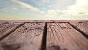 Wooden deck with a view of the sky. Low angle of a wooden deck  with a view of the sky stock video