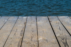 Wooden deck by water Royalty Free Stock Photos