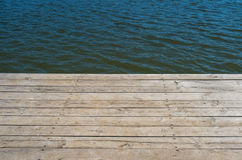 Wooden deck by water background Royalty Free Stock Photo