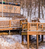 Wooden deck in a wooded area covered in snow Royalty Free Stock Image