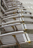 Wooden deckchairs Stock Image
