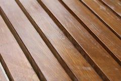 Wooden decking. Background of dark brown wooden decking Royalty Free Stock Photo