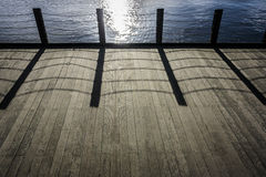 Wooden Decking with Chain Link Shadow Royalty Free Stock Photo