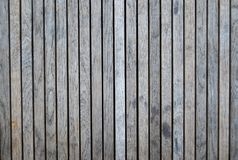 Wooden decking grey in colour. And weathered with vertical lines Stock Photography