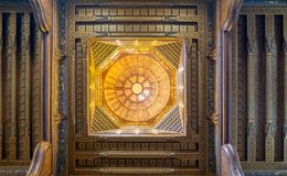 Wooden decorated dome mediating ornate ceiling with floral pattern decorations at al Ghuri Mausoleum, Cairo, Egypt. Wooden decorated dome mediating ornate royalty free stock image