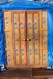 Wooden decorated orange door Royalty Free Stock Photo