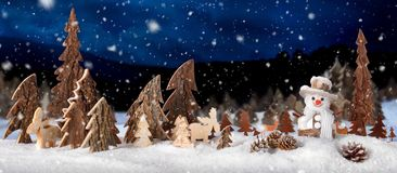 Wooden decoration as a cute winter night scene royalty free stock photography