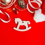 Wooden decoration on the Christmas tree on a red background royalty free stock photo