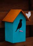 Wooden decoration, craft idea – bird house. Decorative home idea stock photo