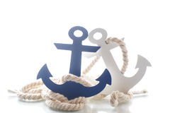 Wooden decorative anchor. On the white background stock photography