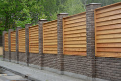 Wooden decorative fence around a garden Royalty Free Stock Image