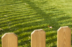 Wooden decorative fence and green garden Stock Photography