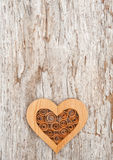 Wooden decorative heart on the old wood Royalty Free Stock Images